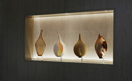 Vonder |  Wall units in anigre wood with stingray-clad recesses for art
