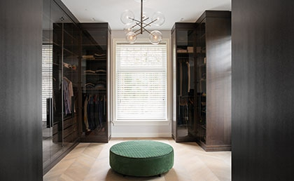 Vonder | bespoke walk-in wardrobe in walnut and  smoked-glass doors